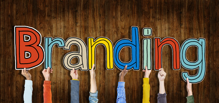 Diverse Hands Holding the Word Branding