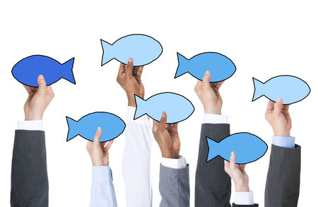 contrasts: Business People Holding Fish Symbol and Contrasts Concept