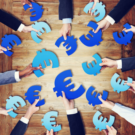 european currency: Group of Hands Holding European Currency Symbol