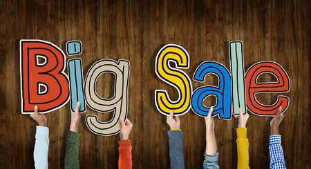 big sale: Group of Hands Holding Word Big Sale