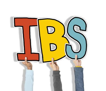 constipated: Grupo de manos que sostienen IBS Carta Foto de archivo