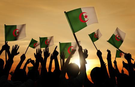 algerian flag: Silhouettes of People Holding Flag of Algeria