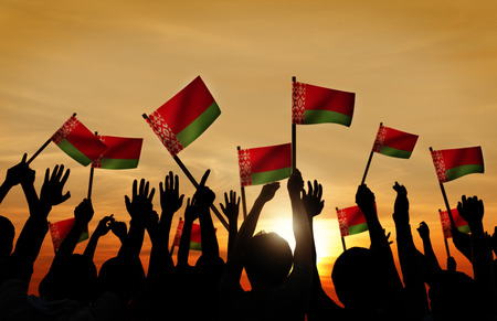 belarusian ethnicity: Silhouettes of People Holding Flag of Belarus