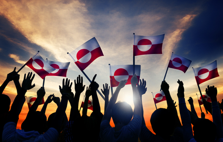 greenlandic: Silhouettes of People Holding Flag of Greenland