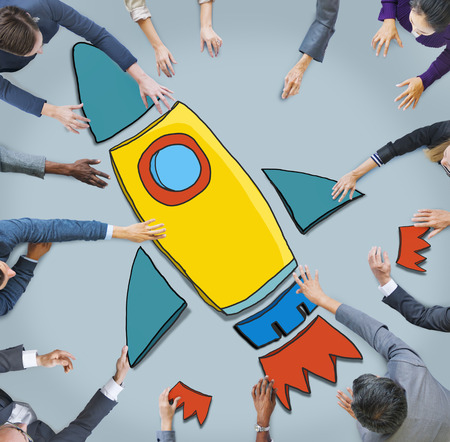 rocketship: Group of Business People Reaching for Rocket Symbol Stock Photo