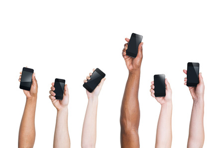 hand out: Multi-Ethnic Arms Raising Smartphones and One Standing Out Stock Photo