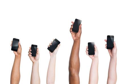 Multikulturelle Arme Raising Smartphones und One Standing Out Standard-Bild - 35337316