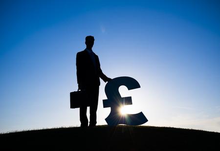 franc: Businessman holding the Franc currency symbol