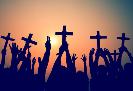worship praise: Hands Holding Cross Christianity Religion Faith Concept Stock Photo