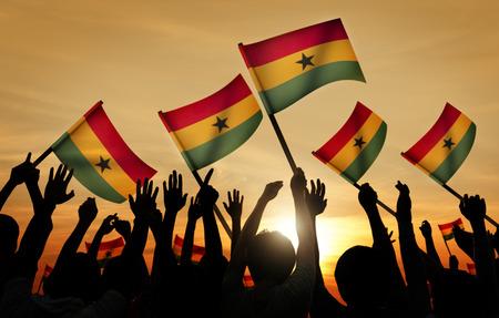 ghana: Silhouettes of People Holding Flag of Ghana
