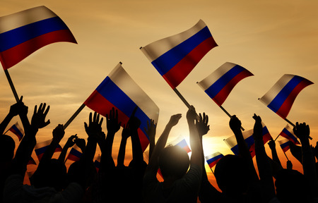 russian ethnicity: Silhouettes of People Holding Flag of Russia