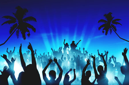 Silhouettes of People in an Outdoor Concert Stock Photo