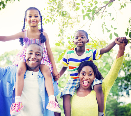 african american: Family Bonding Happiness Togetherness Park Concept Stock Photo