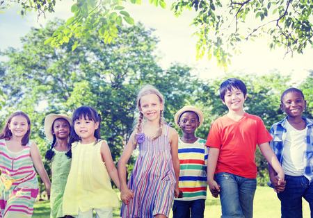 diverse hands: Diverse Children Friendship Playing Outdoors Concept Stock Photo
