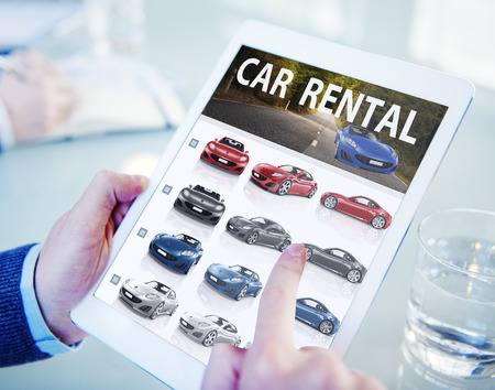 rental: Hands Holding Digital Tablet Car Rental Stock Photo