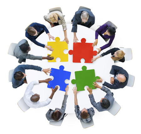 multiethnic: Business People with Jigsaw Puzzle and Teamwork Concept Stock Photo