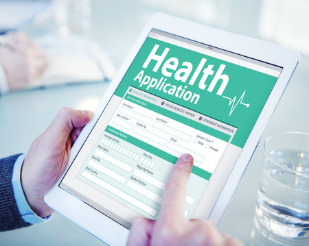 a medical technology: Digital Health Insurance Application Form Concept Stock Photo