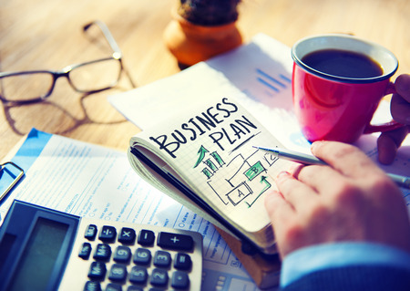 business plan: Businessman Writing Business Plan Growth Concept