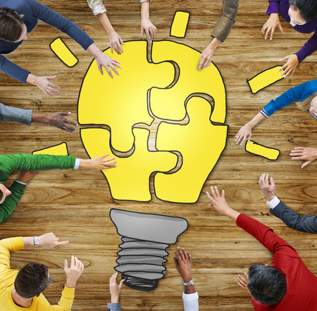 forming: People with Jigsaw Puzzle Forming Light Bulb in Photo and Illustration