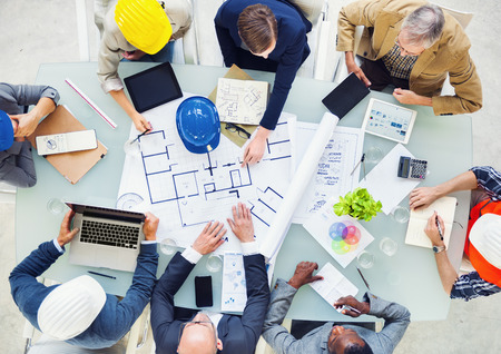 group training: Group of Architects Planning on a New Project Stock Photo