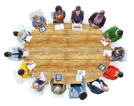 Diverse People Working Around the Conference Table photo