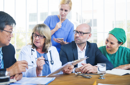 Healthcare Workers Having a Meeting Stock Photo