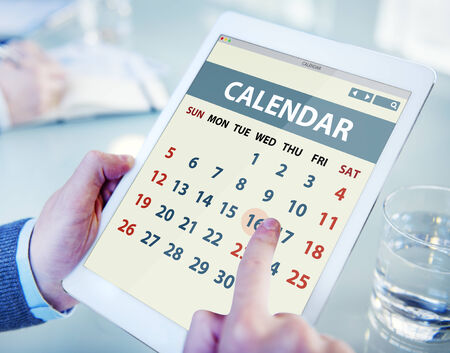 do: Hands Holding Digital Tablet Calendar Stock Photo