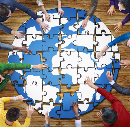 globe puzzle: People with Jigsaw Puzzle Forming Globe in Photo and Illustration