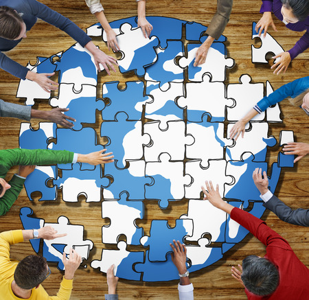 forming: People with Jigsaw Puzzle Forming Globe in Photo and Illustration