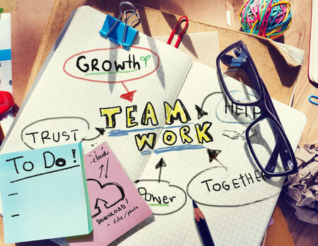 rubber band: Note Pad and Teamwork Concept Stock Photo