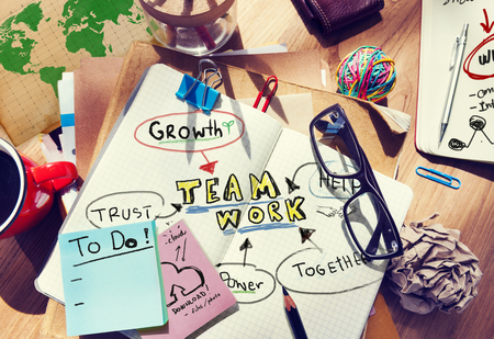 note pad: Note Pad and Teamwork Concept Stock Photo