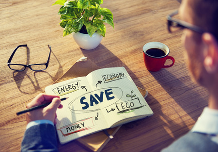 making a save: Businessman with Energy and Environmental Concept Stock Photo