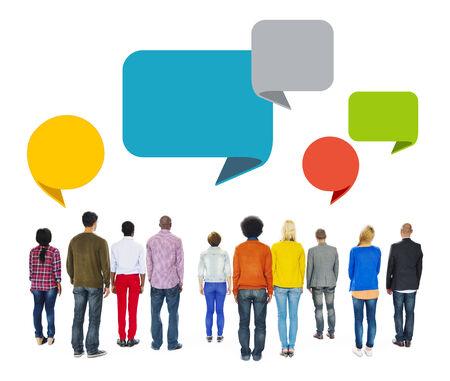 facing backwards: Multiethnic People Facing Backwards with Speech Bubbles