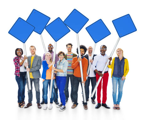 expressing positivity: Group Of Multi-Ethnic People Expressing Positivity Standing And Holding Blue Blank Sign Post In White Background. Stock Photo