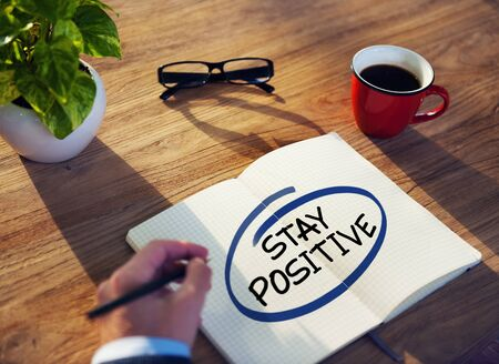 hopeful: Businessman Writing the Words Stay Positive