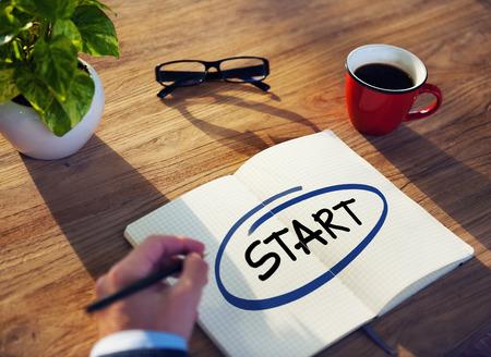 originate: Businessman Writing the Word Start Stock Photo