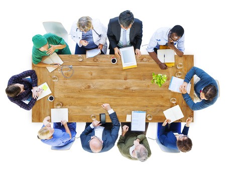 work table: Group of Business People and Doctors in a Meeting Stock Photo