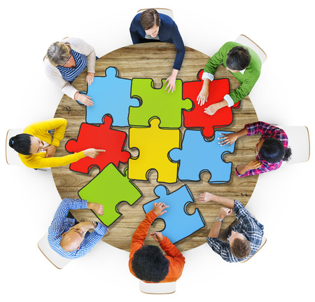 social gathering: Multiethnic Group of People with Jigsaw Puzzle in Photo and illustration Stock Photo