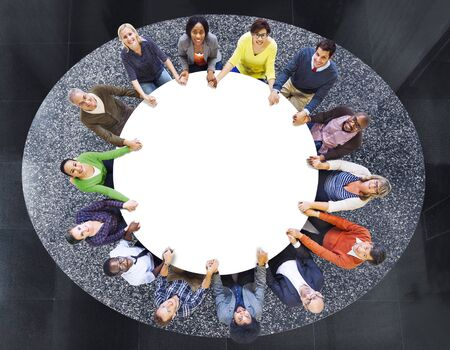 Aerial View of Multiethnic People Around the Table photo