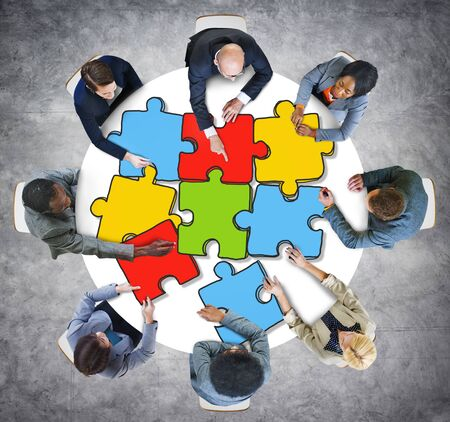 team discussion: Group of Business People with Jigsaw Puzzle in Photo and Illustration Stock Photo