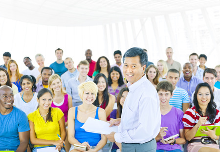 public speaker: Large group of students in Convention Center Stock Photo