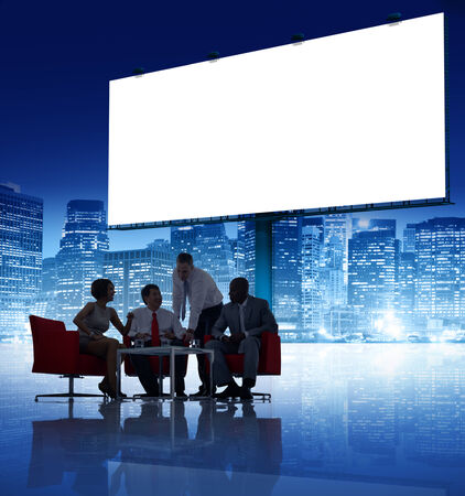 organised group: Group of Business People Meeting with Placard Stock Photo