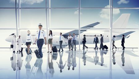 middle eastern ethnicity: Multiethnic Group of Business People with Airplane Stock Photo