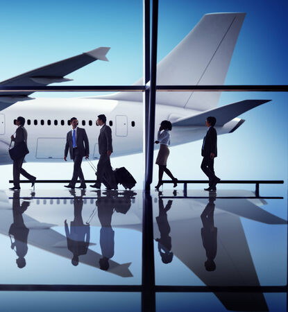 flight mode: Multiethnic Group of Business People with Airplane Stock Photo