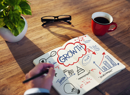 Businessman Sketching About Growth Concept