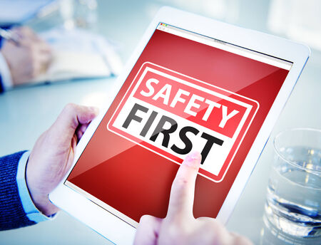 safety first: Hands Holding Digital Tablet Safety First Stock Photo