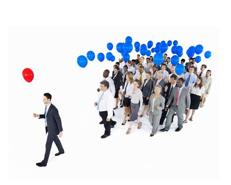 standing out from the crowd: Businessman Standing Out From Crowd with Red and Blue Balloons