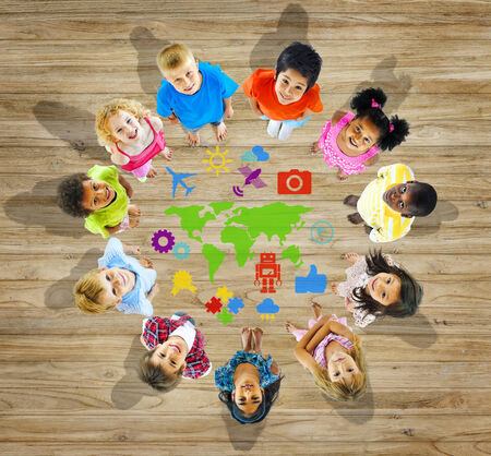 kids studying: Multiethnic Group of Children with World Map