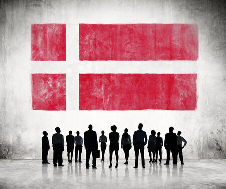 Silhouettes of Business People Looking at the Danish Flag photo
