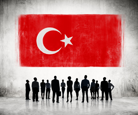 Silhouettes of Business People Looking at the Turkish Flag Stock Photo